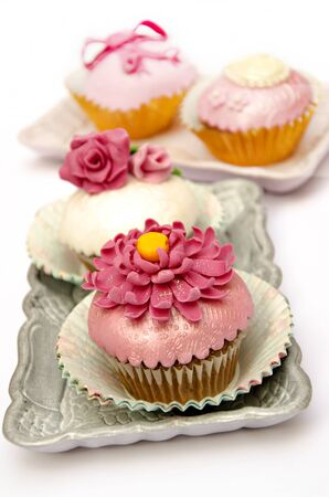 Cupcakes decorated with fondant and sugar flowers Stock Photo - 16513430