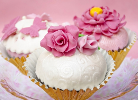 Cupcakes decorated with fondant and sugar flowers Stock Photo