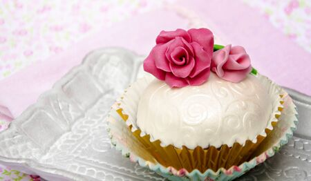 Cupcakes decorated with fondant and sugar flowers Stock Photo - 16513414