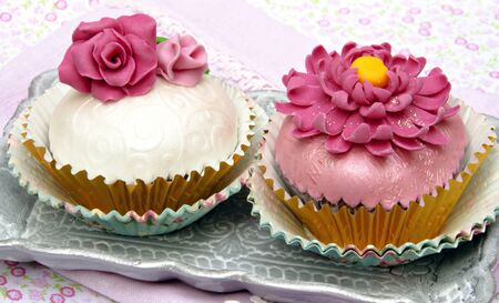 Cupcakes decorated with fondant and sugar flowers Stock Photo - 16513393