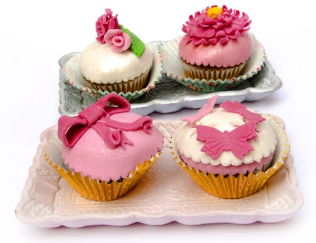 Cupcakes decorated with fondant and sugar flowers Stock Photo - 16513423