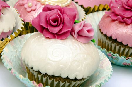Cupcakes decorated with fondant and sugar flowers Stock Photo - 16513409