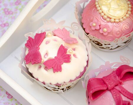 Cupcakes decorated with fondant and sugar flowers Stock Photo - 16513402