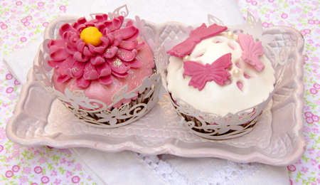 Cupcakes decorated with fondant and sugar flowers Stock Photo - 16513406