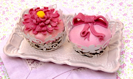 Cupcakes decorated with fondant and sugar flowers Stock Photo - 16513404