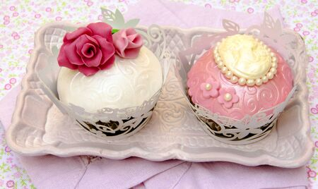 Cupcakes decorated with fondant and sugar flowers Stock Photo - 16513403