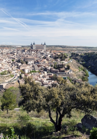 Distant view of the the Spanish city of Toledo, in one side the river tagus, in the background the city of Toledo with its houses Stock Photo - 16963506
