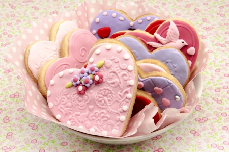 Valentine cookies decorated with heart shape photo