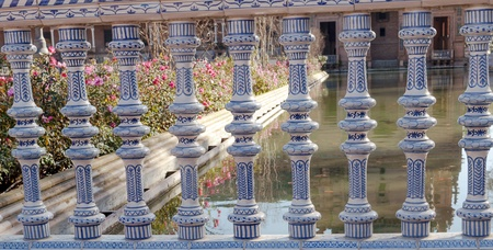 espana: Detail of bridge on Plaza de Espana in Seville, Spain, you can see the lake and some flowers in one side Stock Photo