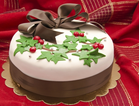 Christmas cake decorated with fondant holly leaves photo