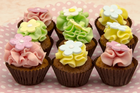 Cupcakes decorated with butter cream and flowers Stock Photo - 18367191