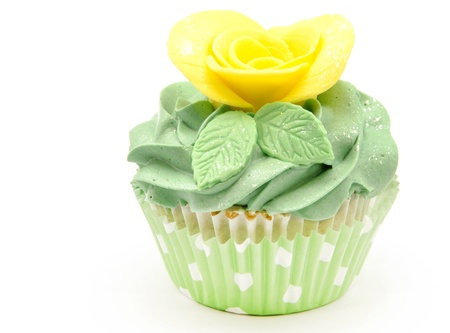 Cupcakes decorated with butter cream and flowers photo