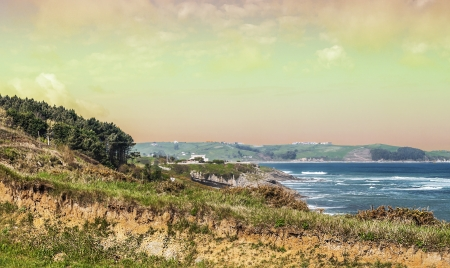 cantabrian: Coastline of Comillas located in the Spanish province of Cantabria in northern Spain. It�s cantabrian sea with waves at sunset. Stock Photo