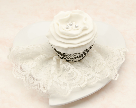 Vintage Cupcake served in a heart shaped dish photo