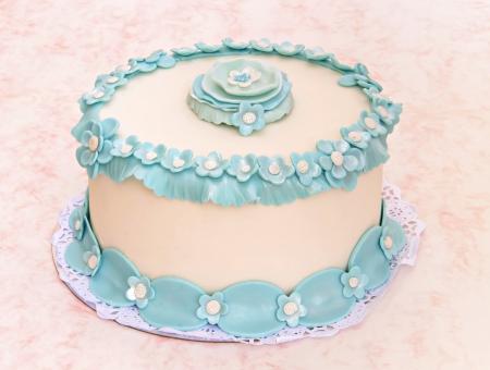 wedding cake: Wedding cake decorated with blue fondant flowers Stock Photo