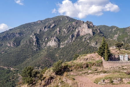 spainish: Mountains of Castejon situated in the spainish province of Huesca in pyrenees mountain. It�s picture taken in a sunny day. You can see the cemetery of the village Stock Photo