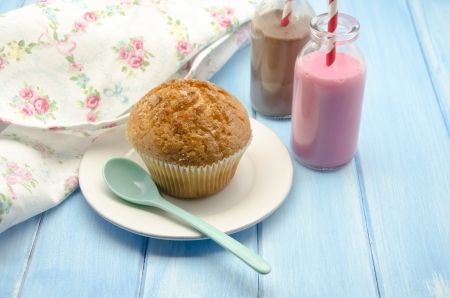 Muffins and chocolate and strawberry milk photo