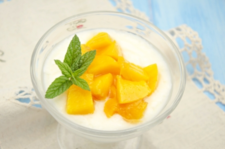 Yogurt with peaches in syrup photo
