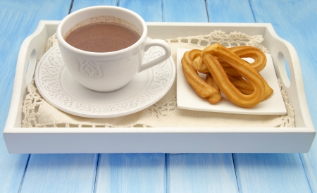 churros: Cup of hot chocolate and several Churros