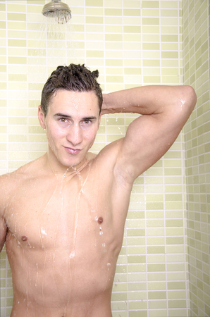 Young man in the shower photo