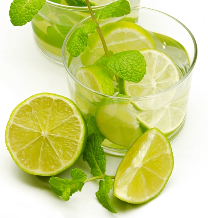 Mojito with lime and mint on white background photo