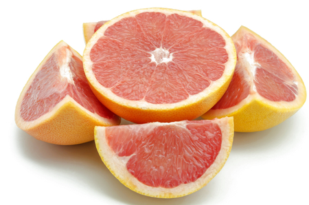 Fresh red grapefruit cut into pieces