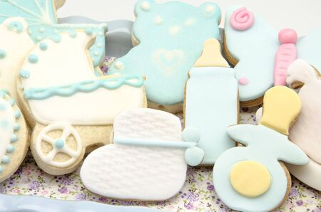 Several cookies baked and decorated with fondant photo