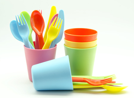 Plastic cups and forks photo