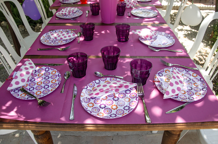 Table Decorated With Colorful Tablecloths And Crockery Photo