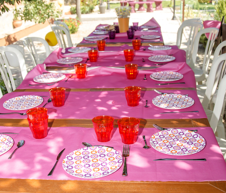 #29465865   Table Decorated With Colorful Tablecloths And Crockery
