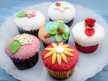 Cupcakes decorated with fondant served on a tray photo