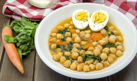 Chickpea stew with spinach and carrots typical of Spain photo