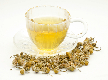 Infusion of chamomile aromatic hot served in a glass cup photo