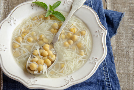 Hot chickpea soup with noodles photo