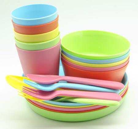 Plastic tableware in various colors photo