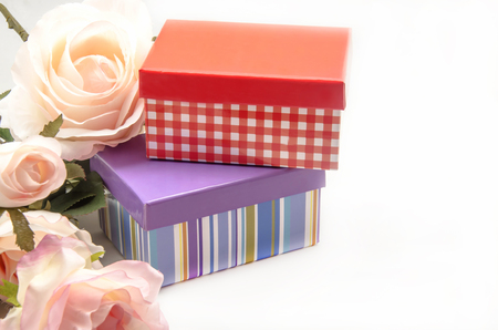 Gift box with ribbon on white background photo