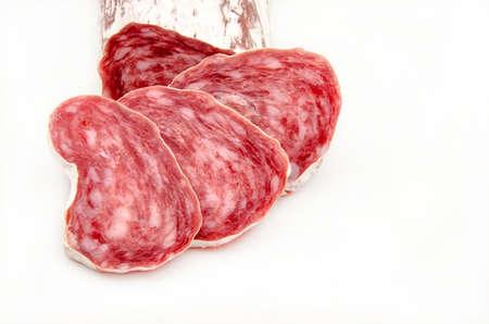 Iberico cured salami sliced ??on white background photo