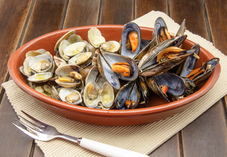 Clams and mussels with garlic served in a casserole photo
