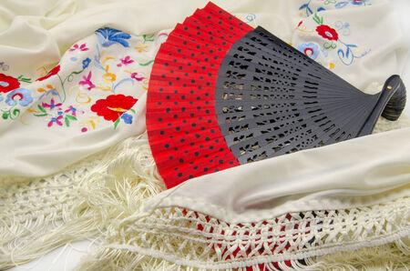 flemish: Spanish Abanico on manila shawl embroidered with flowers