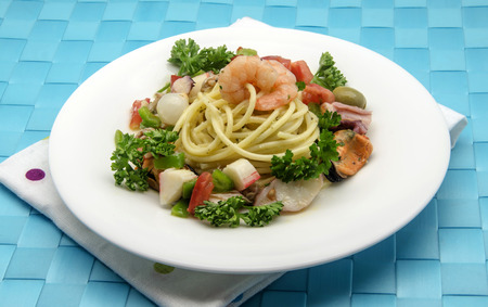 Spaghetti with seafood salad served on a plate photo