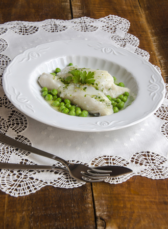 bacalao: Bacalao al pil pil with peas Stock Photo