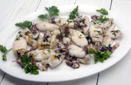 elusive: Grilled squid cooked with garlic and parsley Stock Photo