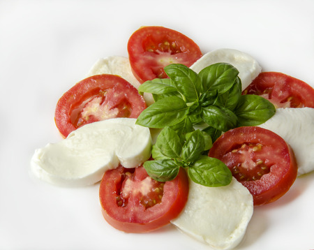 caprese: Caprese salad with tomato and mozzarella cheese Stock Photo