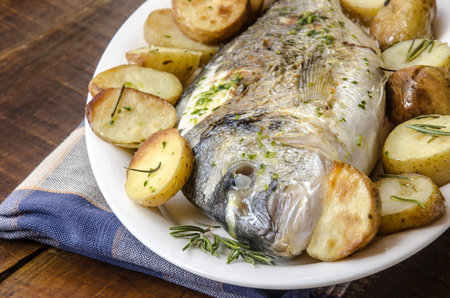 baked: Baked fish with roasted potatoes Stock Photo