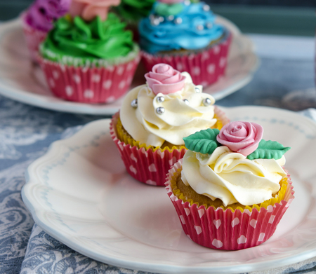 cream cake: Cupcakes decorated with butter cream in various colors