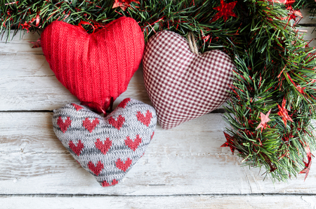 the tinsel: Christmas ornaments, tinsel and red hearts fabric