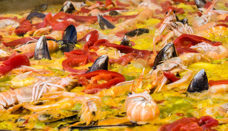 marisco: Fund seafood paella and vegetables Stock Photo