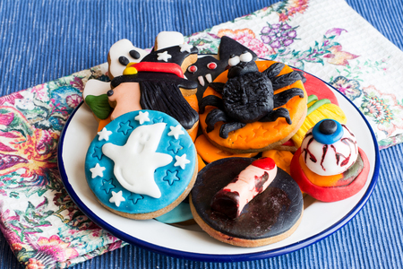 Close-up of delicious homemade cookies on halloween theme on towel in daylight Stock Photo