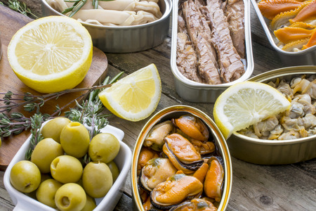 sardine can: Assortment of cans of canned with different types of fish and seafood