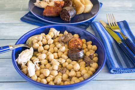 Madrid stew, typical Spanish dish with chickpeas, vegetables and meat Stock fotó